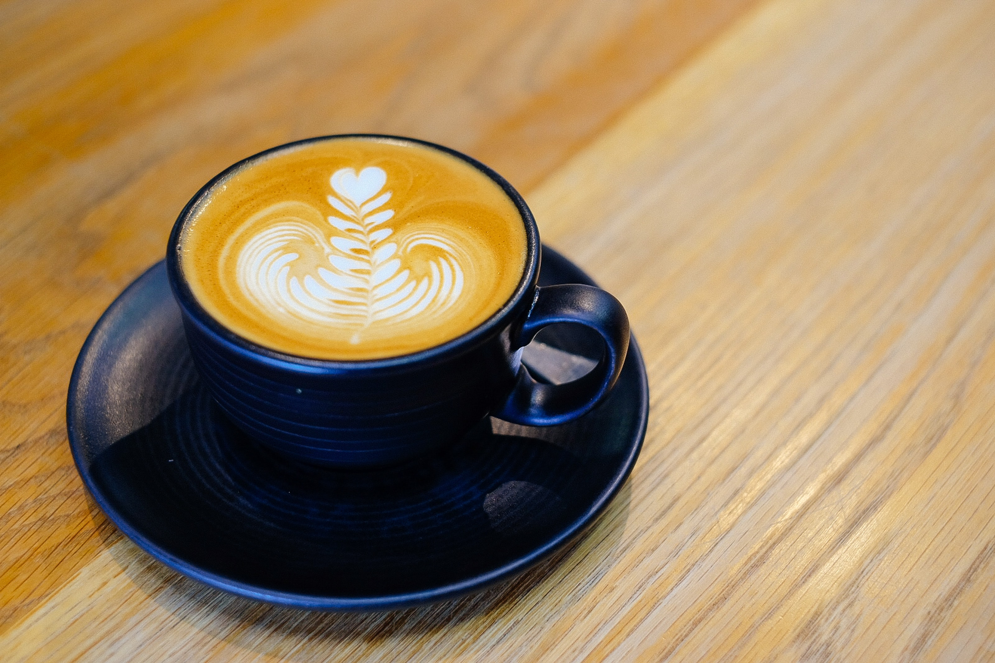 blue ceramic mug filled with cappuccino