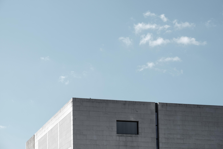 gray building under calm sky