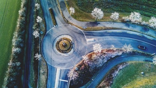 aerial photography of vehicle cross road
