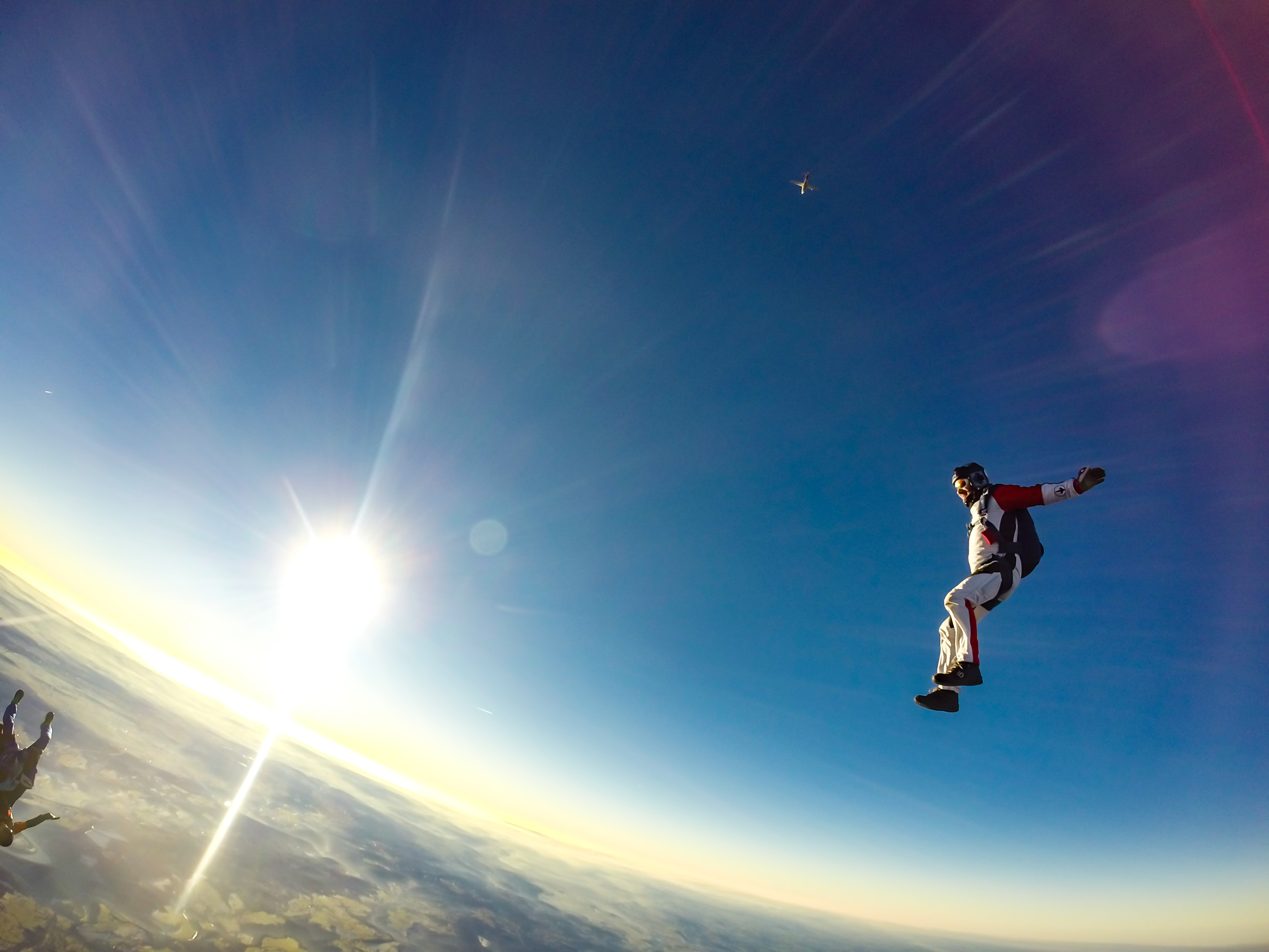 man jumping in sky during daytime