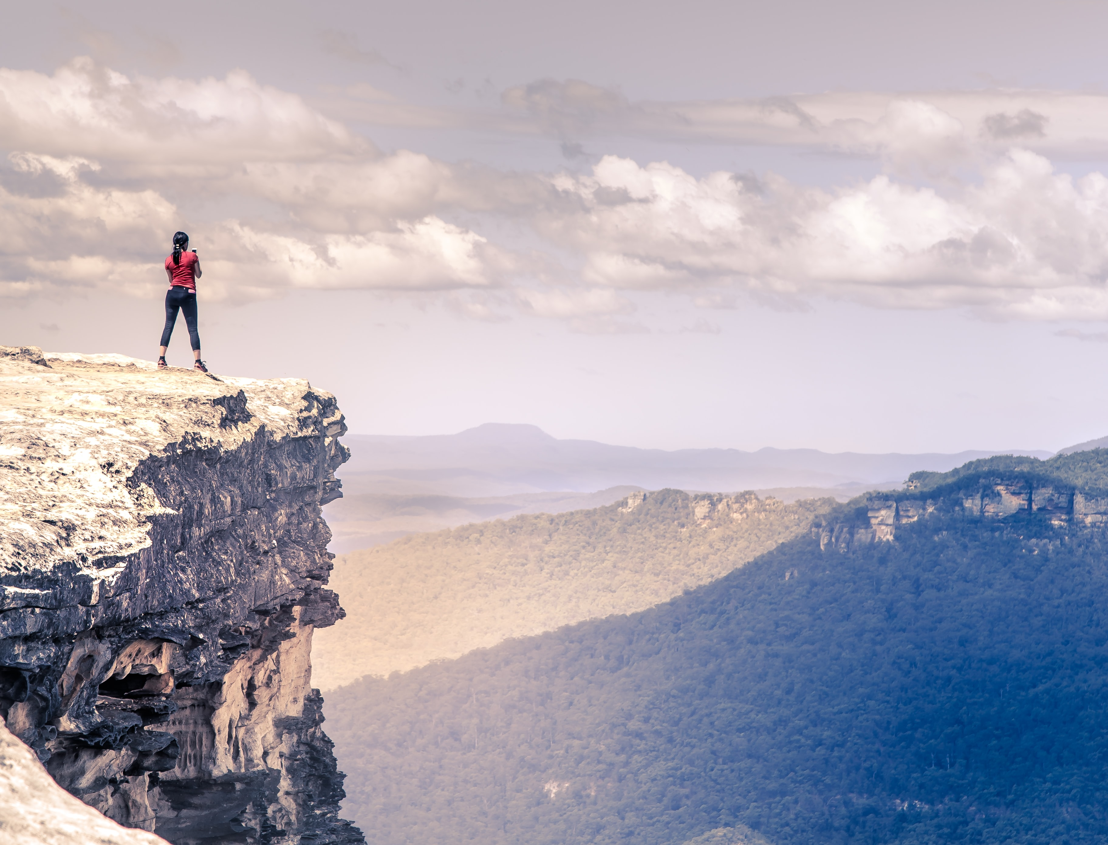 rule of thirds photography of woman on top of mountain
