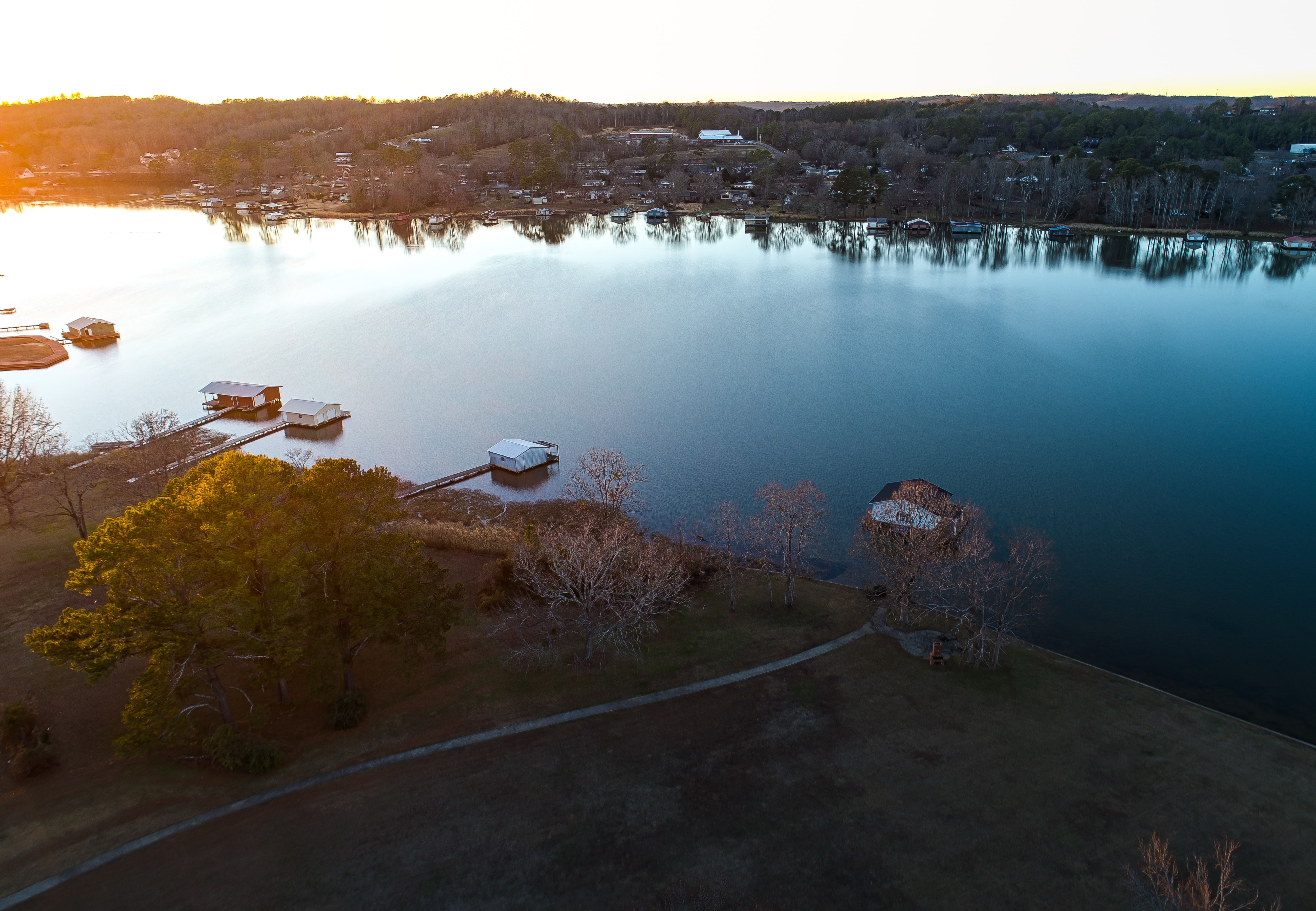 Aerial view shot with a drone of boathouses in Guntersville, Alabama during sunset