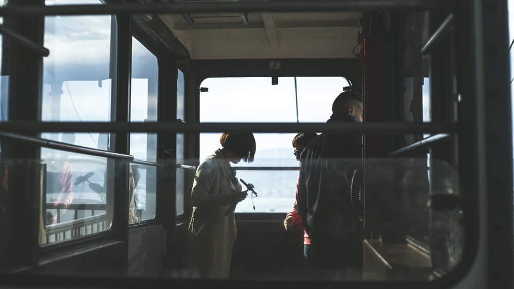 woman and man inside cable car