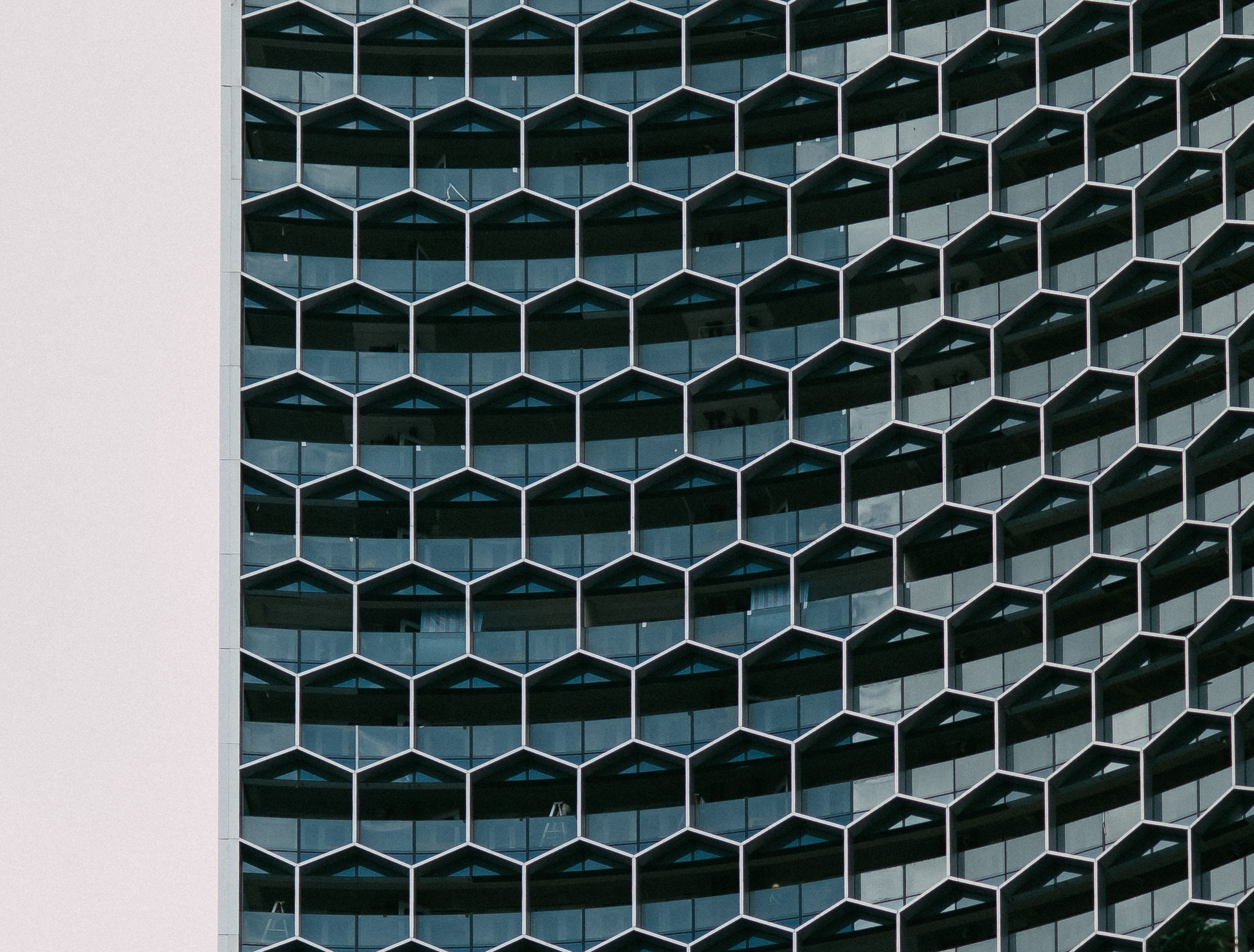 A building with glass hexagon shaped windows