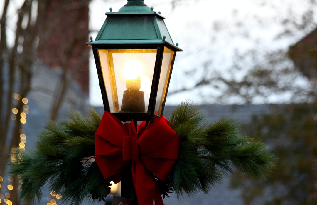 This is a shot of a decorated lamp post in Williamsburg on New Year's Eve. The air was chilly and clear as the last few hours of the year were ticking away. As we walked down the cobblestone street, this little lamp post caught our eye; a light at the end of the tunnel - the spark of a new beginning.