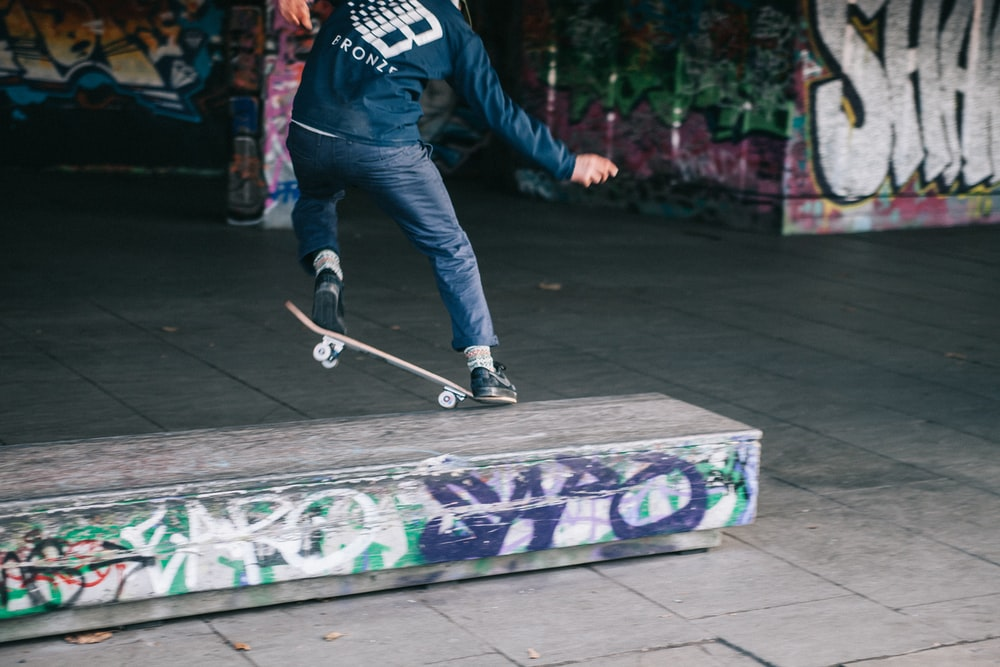 person doing nose grind on ledge