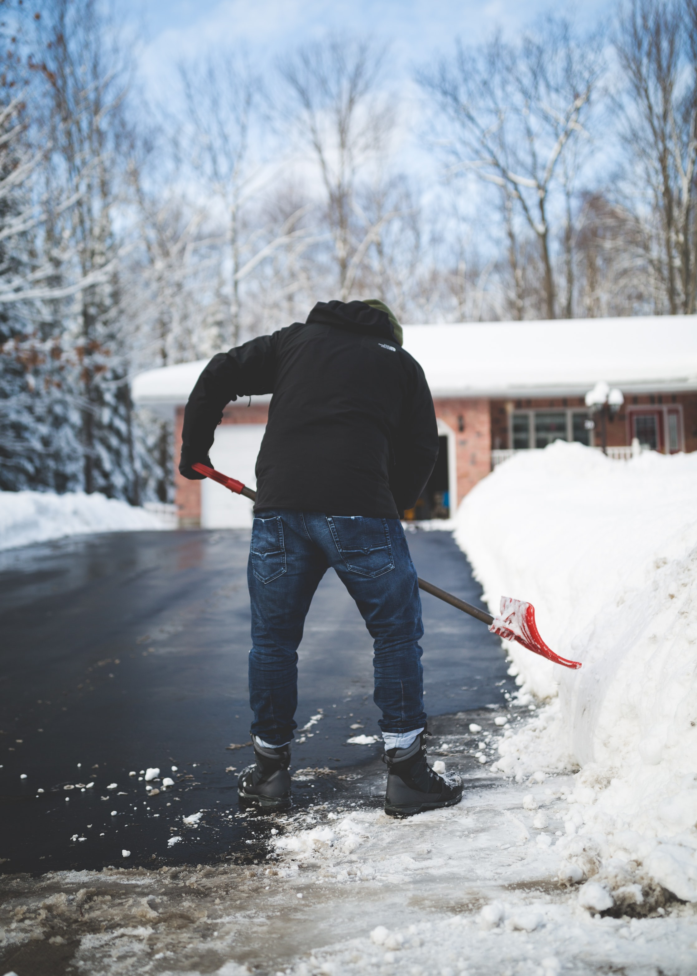 A man shoveling snow off his driveway in Muskoka