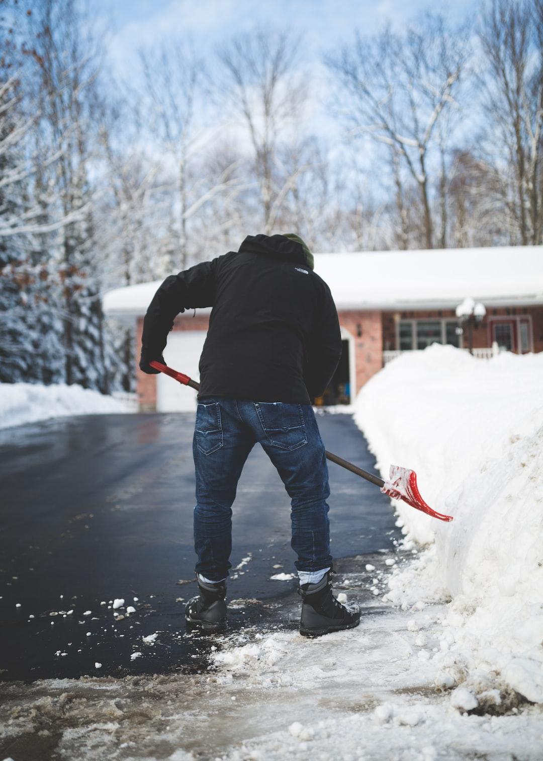A man shoveling snow off his driveway in Muskoka