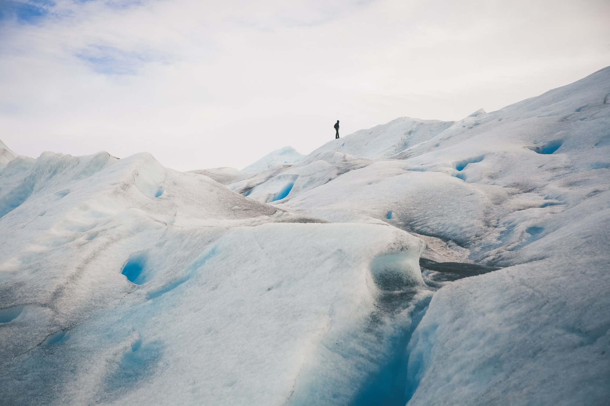 Tour guide exploring trekking conditions on Perito Moreno glacier. Patagonia is where you feel you get the most from life.