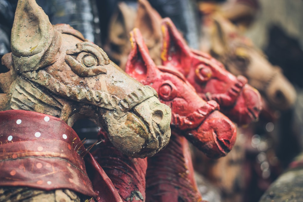 close-up photo of horse statues