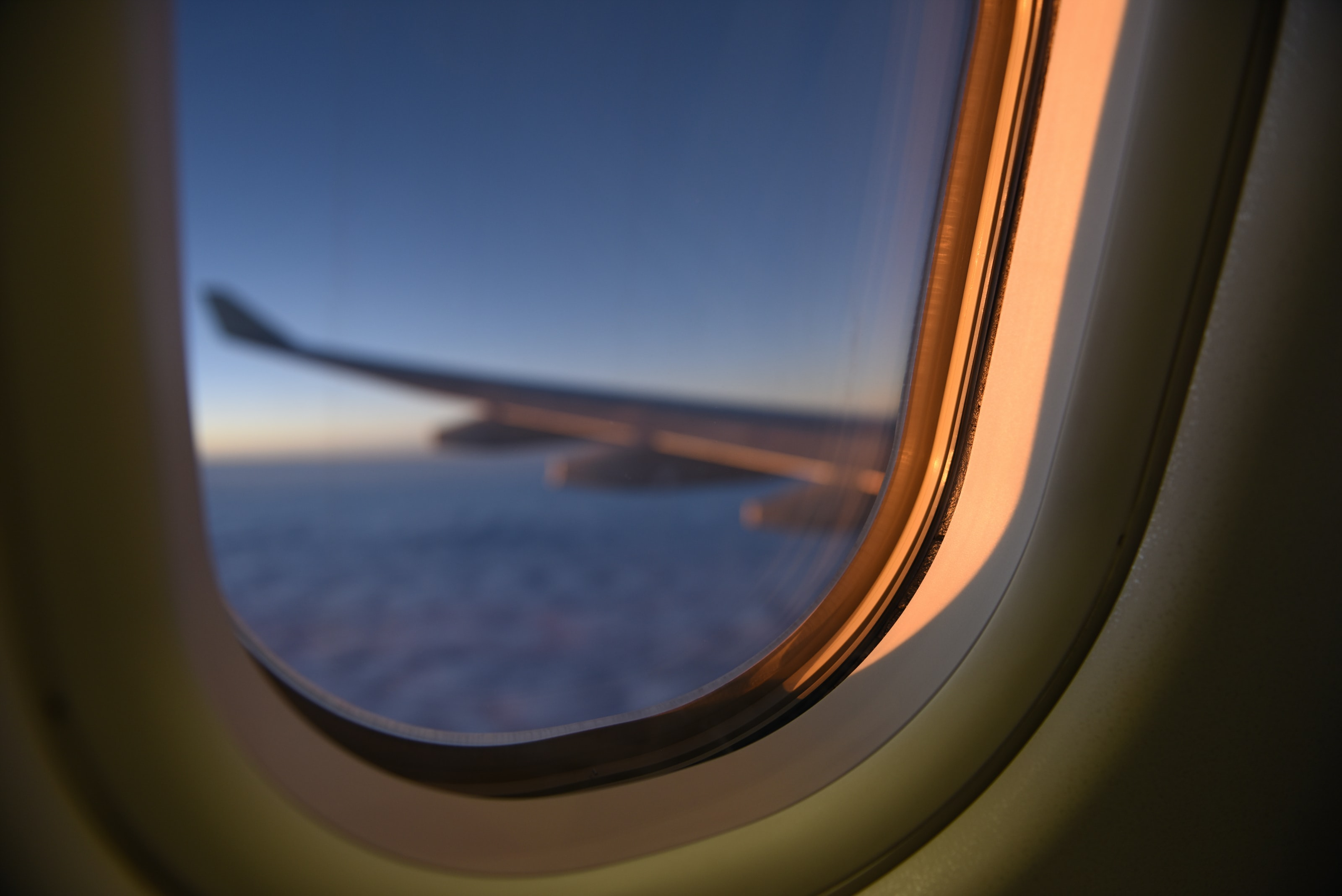 A blurry view from an oval plane window