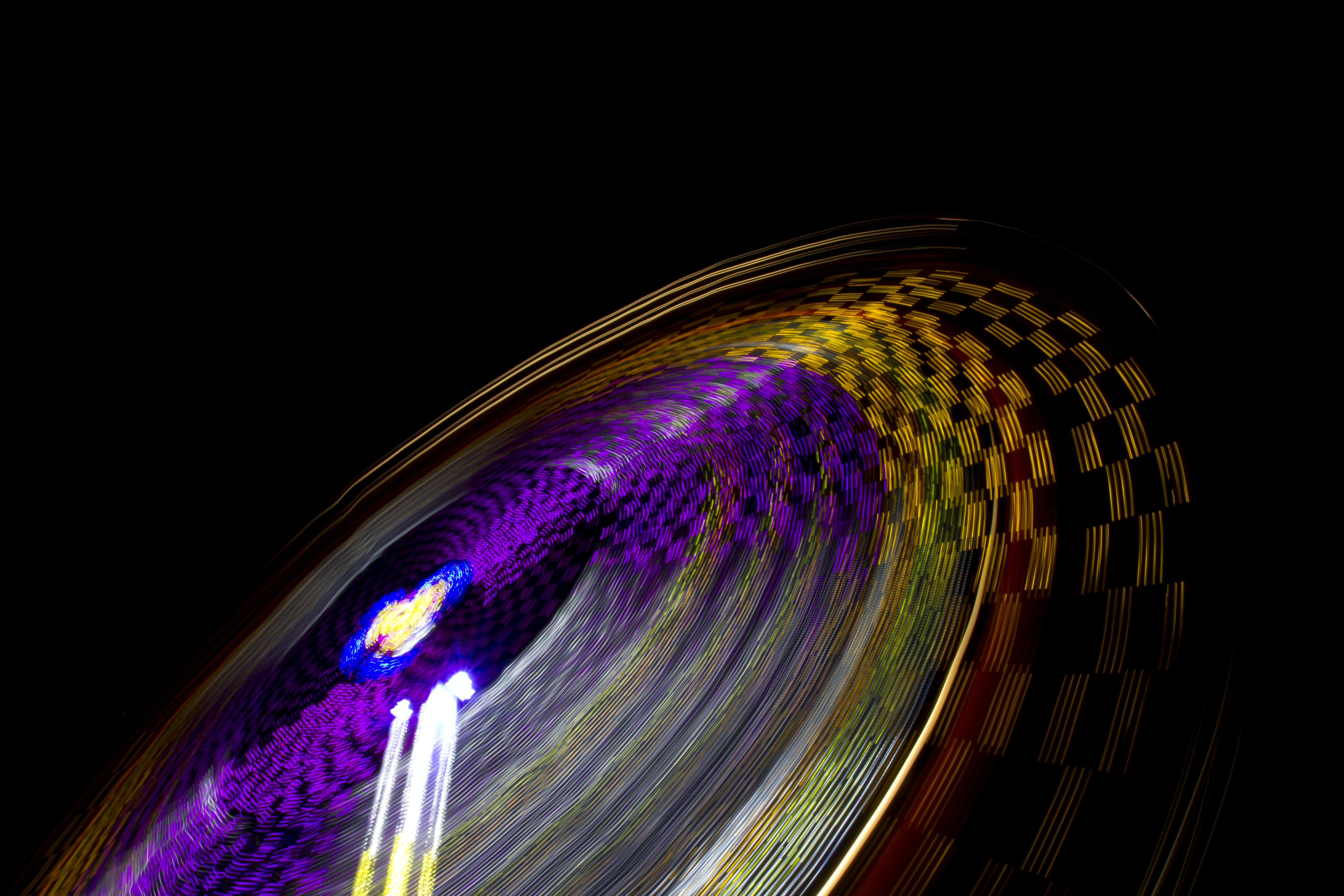 time lapse photography of multicolored amusement ride