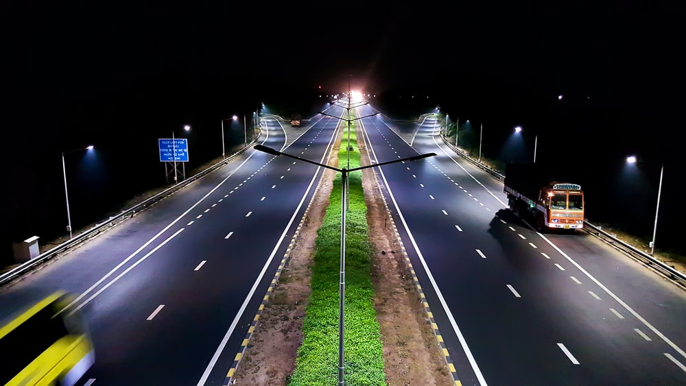 vehicles traveling on roads at night
