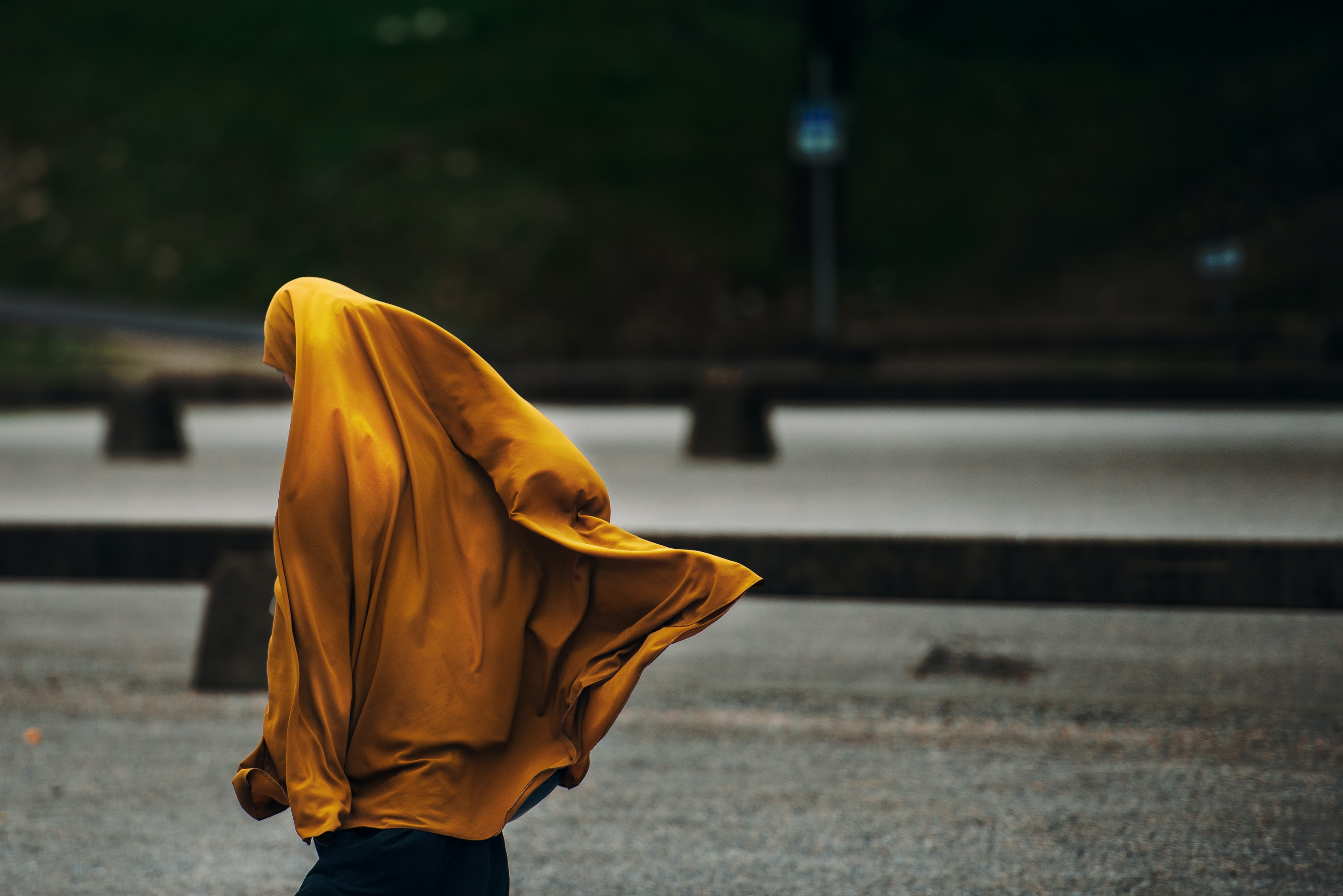 person wearing yellow jacket