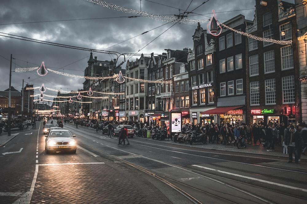 crowd of people walking on the street