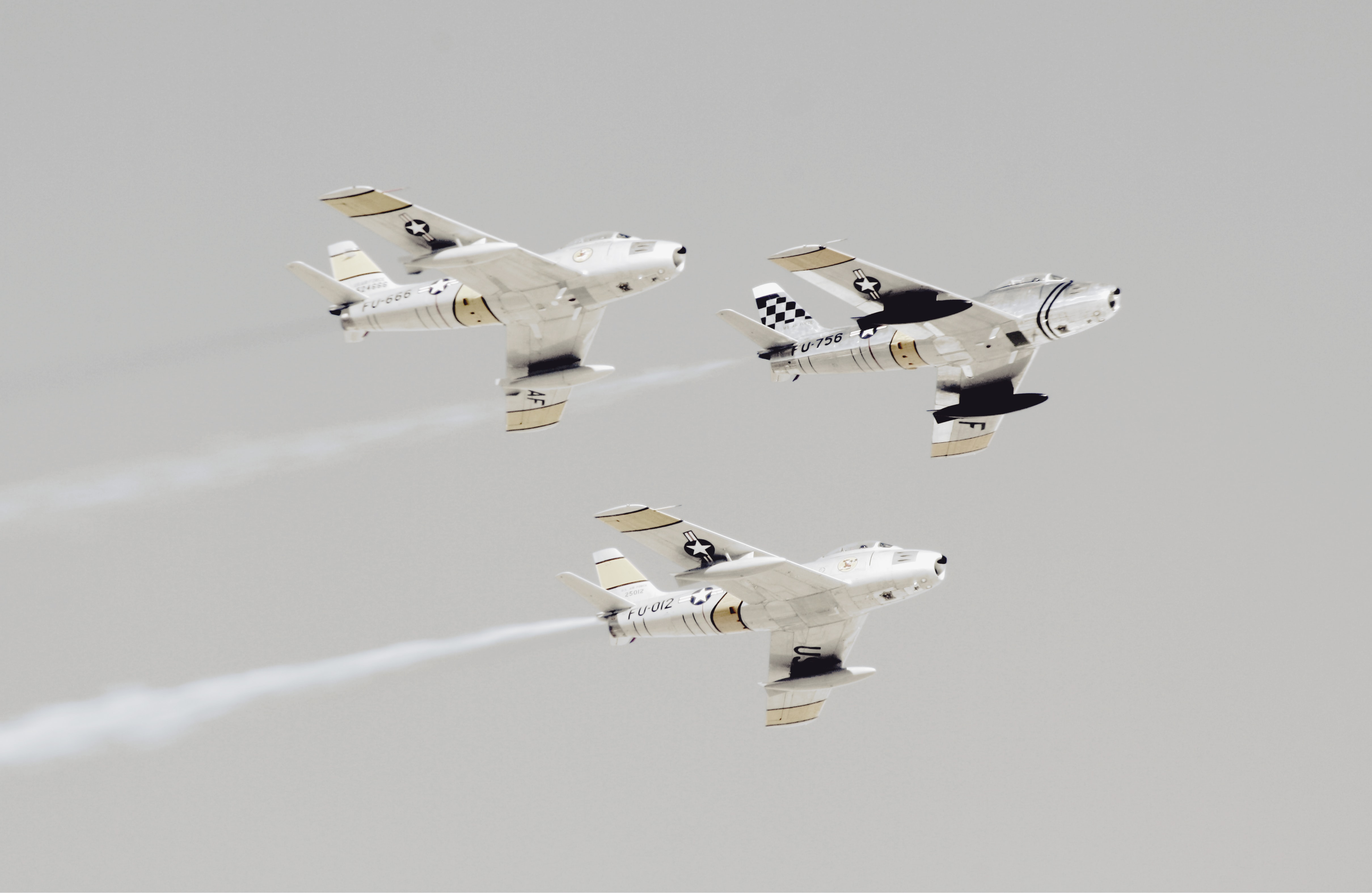 three white-and-black jet planes