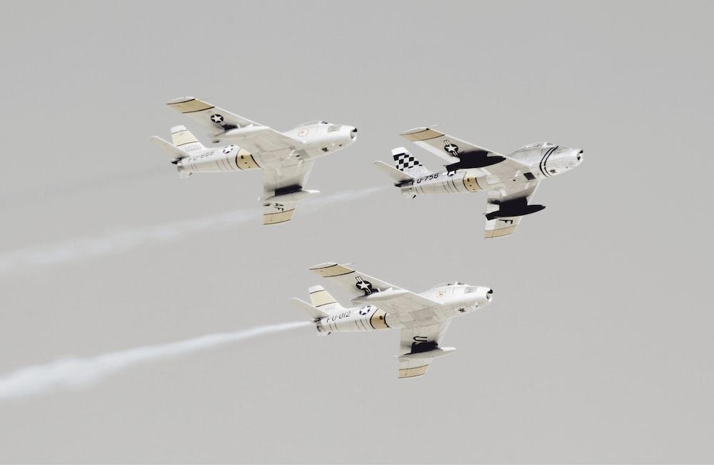 three white-and-black jet planes