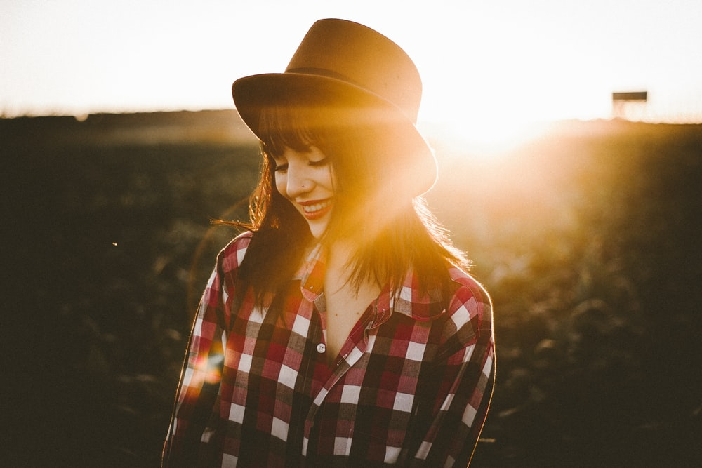 woman in white and red checkered dress shirt