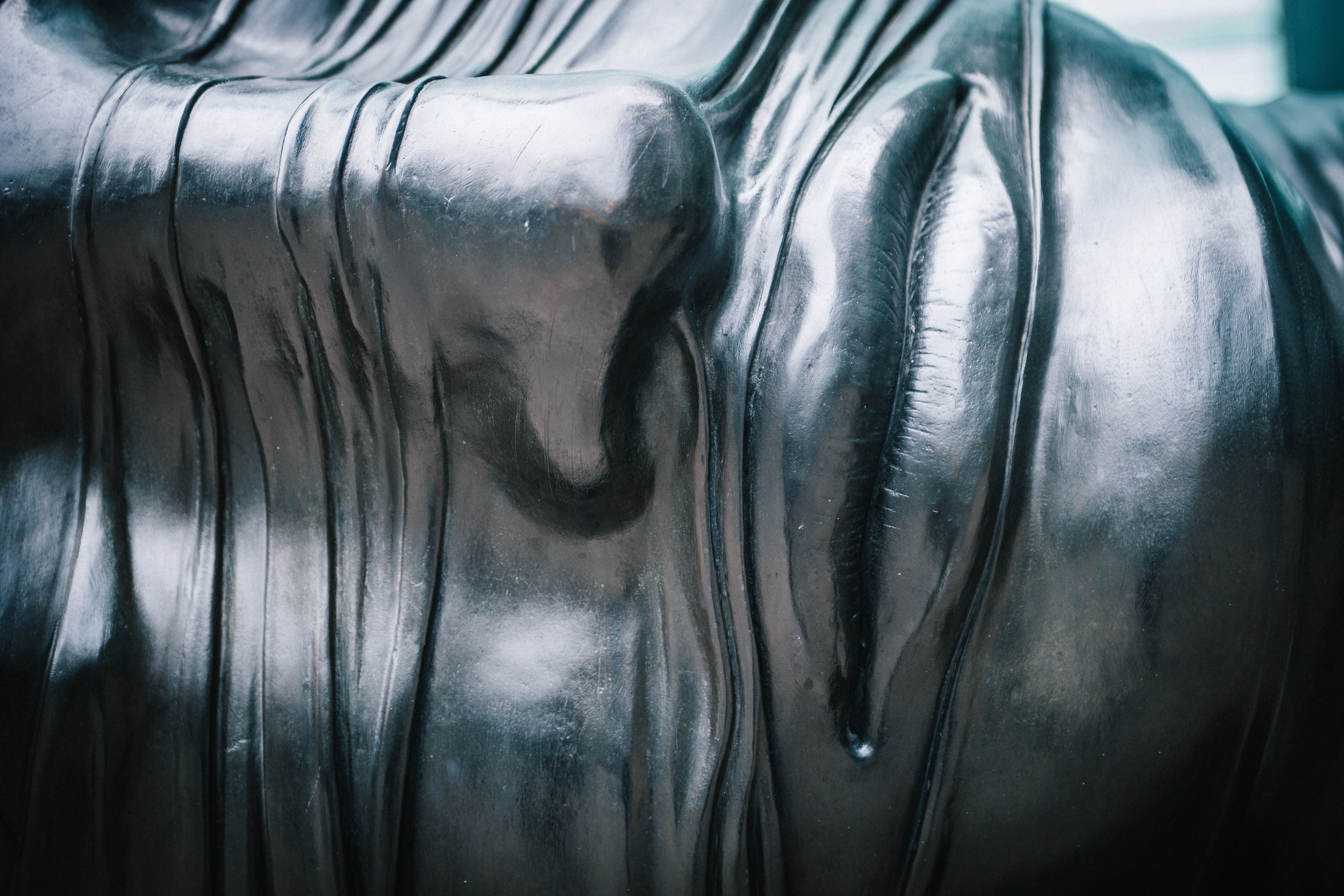 Close up of modern metal sculpture of human face at Canary Wharf