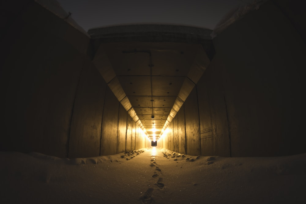 sand on hallway with yellow light
