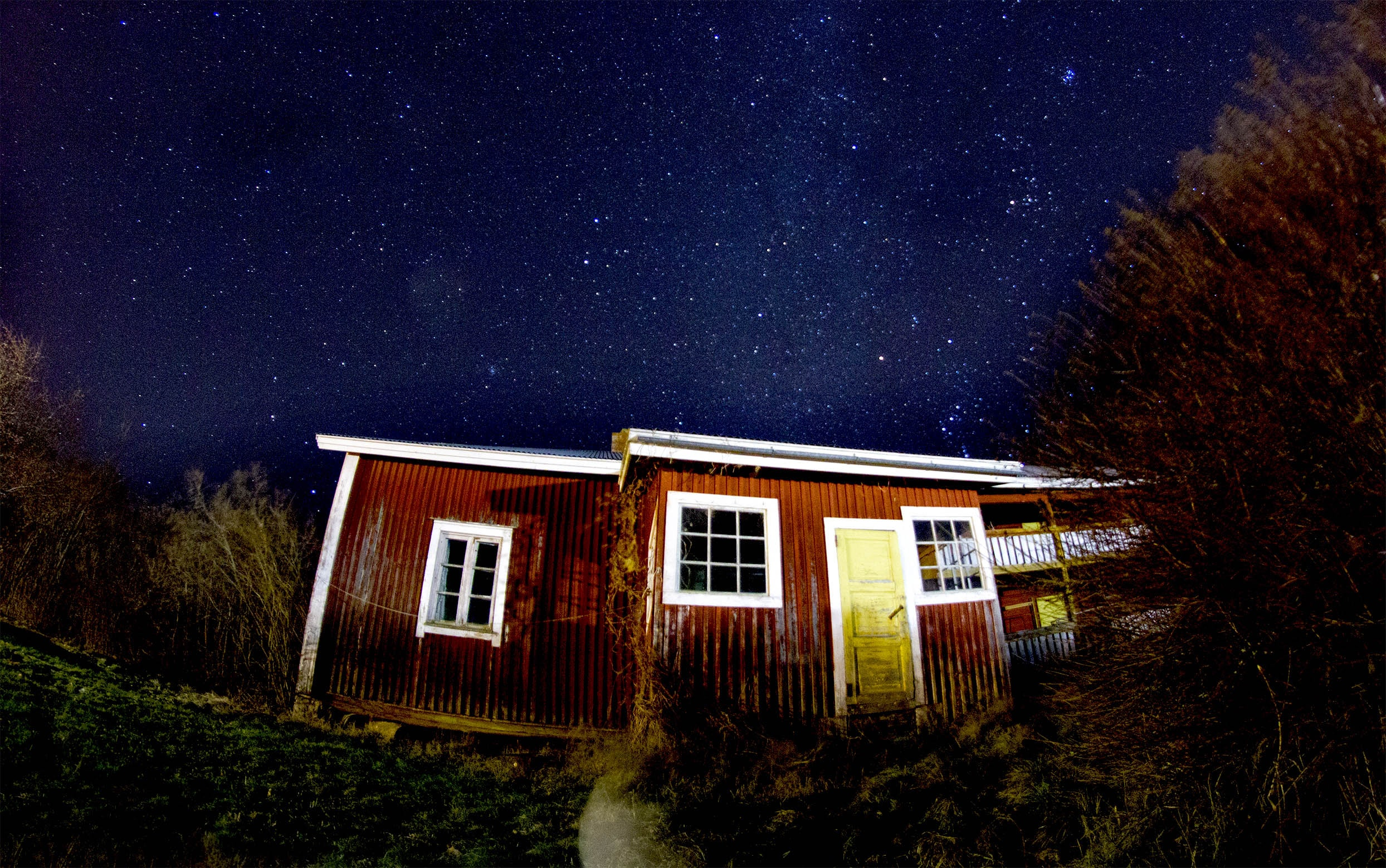 low angle view photography of brown house during night time