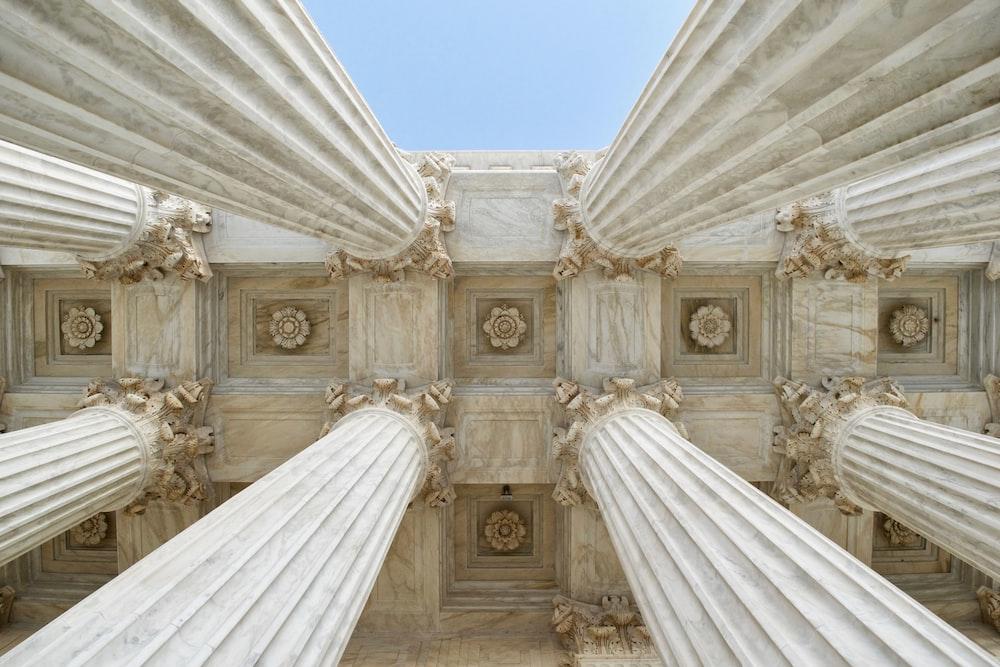 gray stone columns worm's-eye view photo