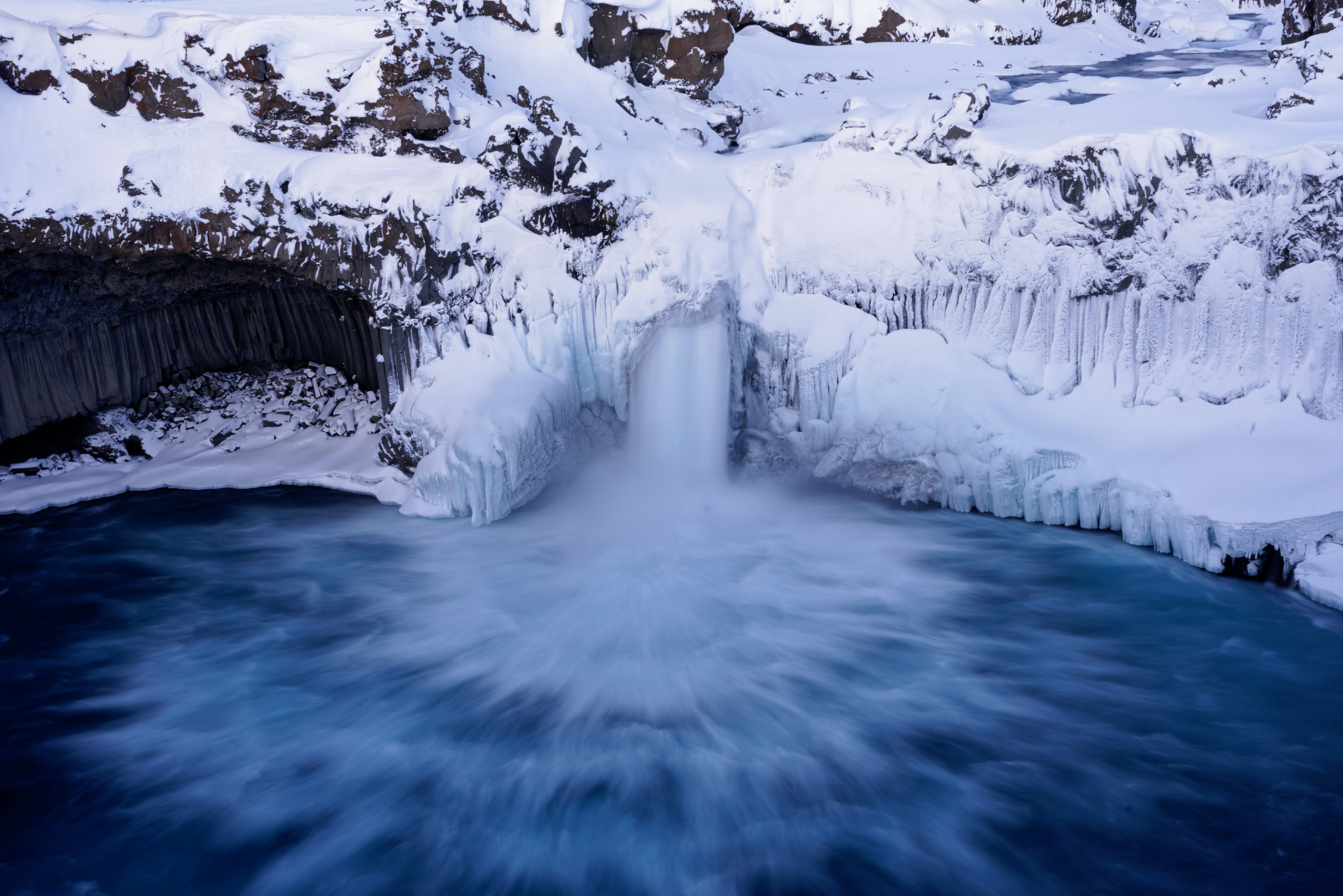 A waterfall flowing in the ocean at Aldeyjarfoss in Iceland