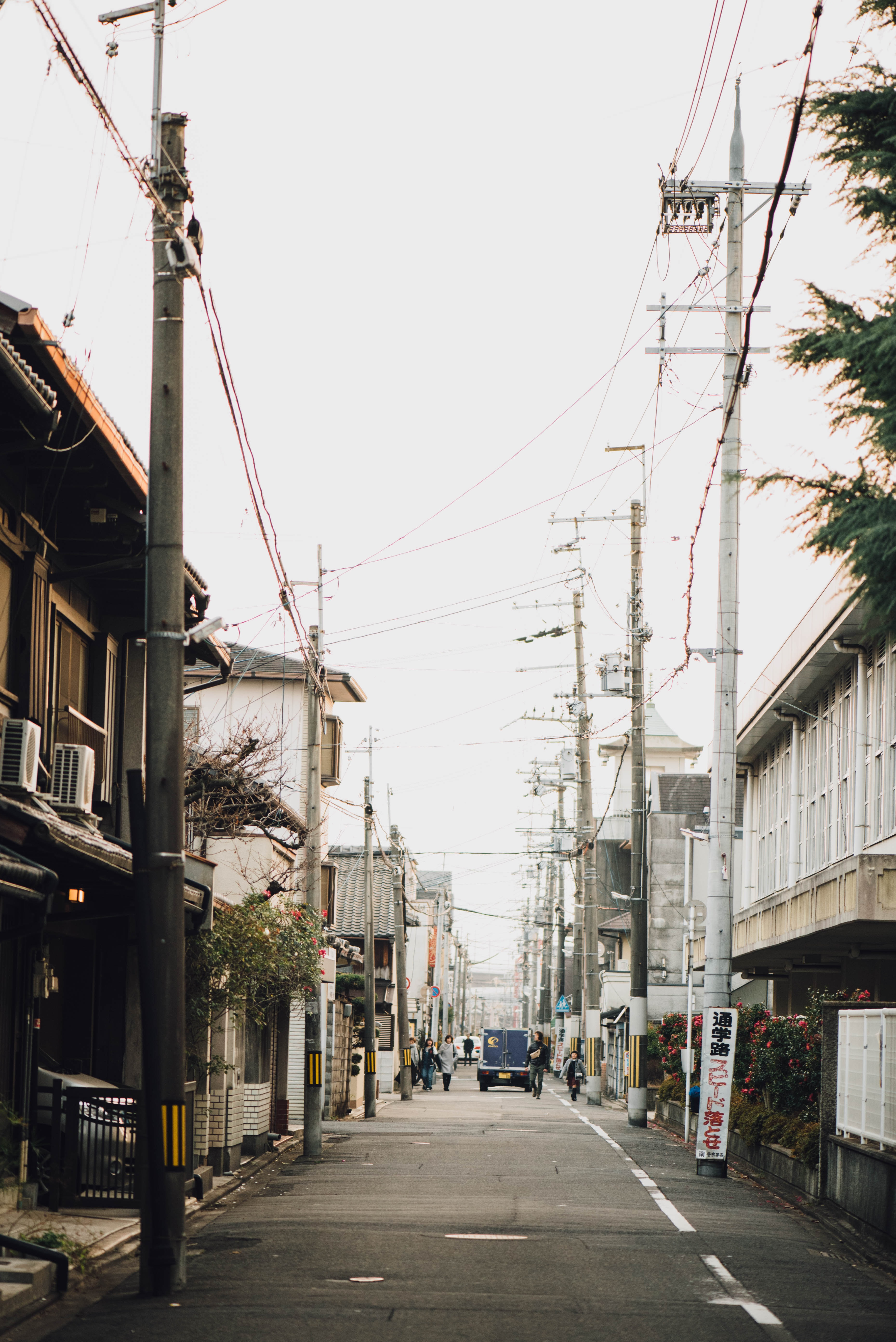 An empty street with power lines overhead.