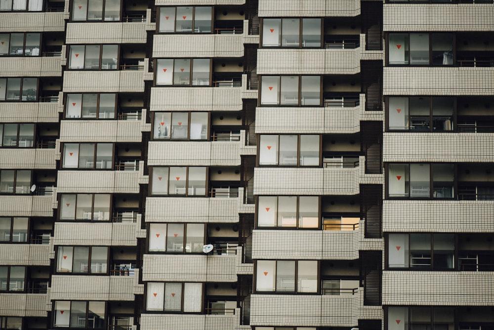 photo of white condo unit during daytime