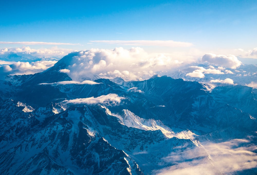 mountain ranges covered in clouds