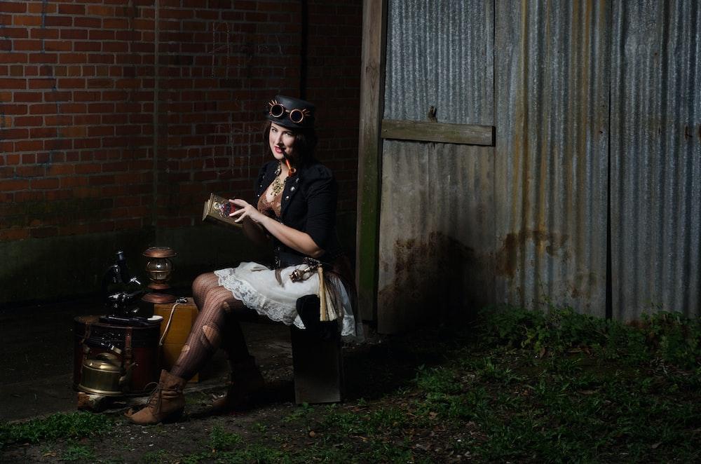 woman sitting on barrel