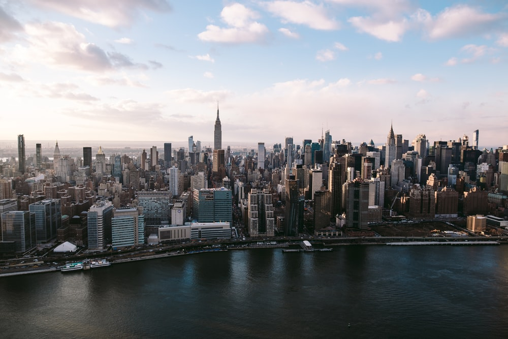 The skyline of New York under fluffy clouds