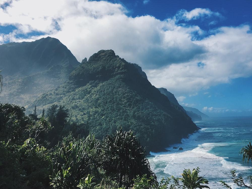 landscape photography of mountain near sea