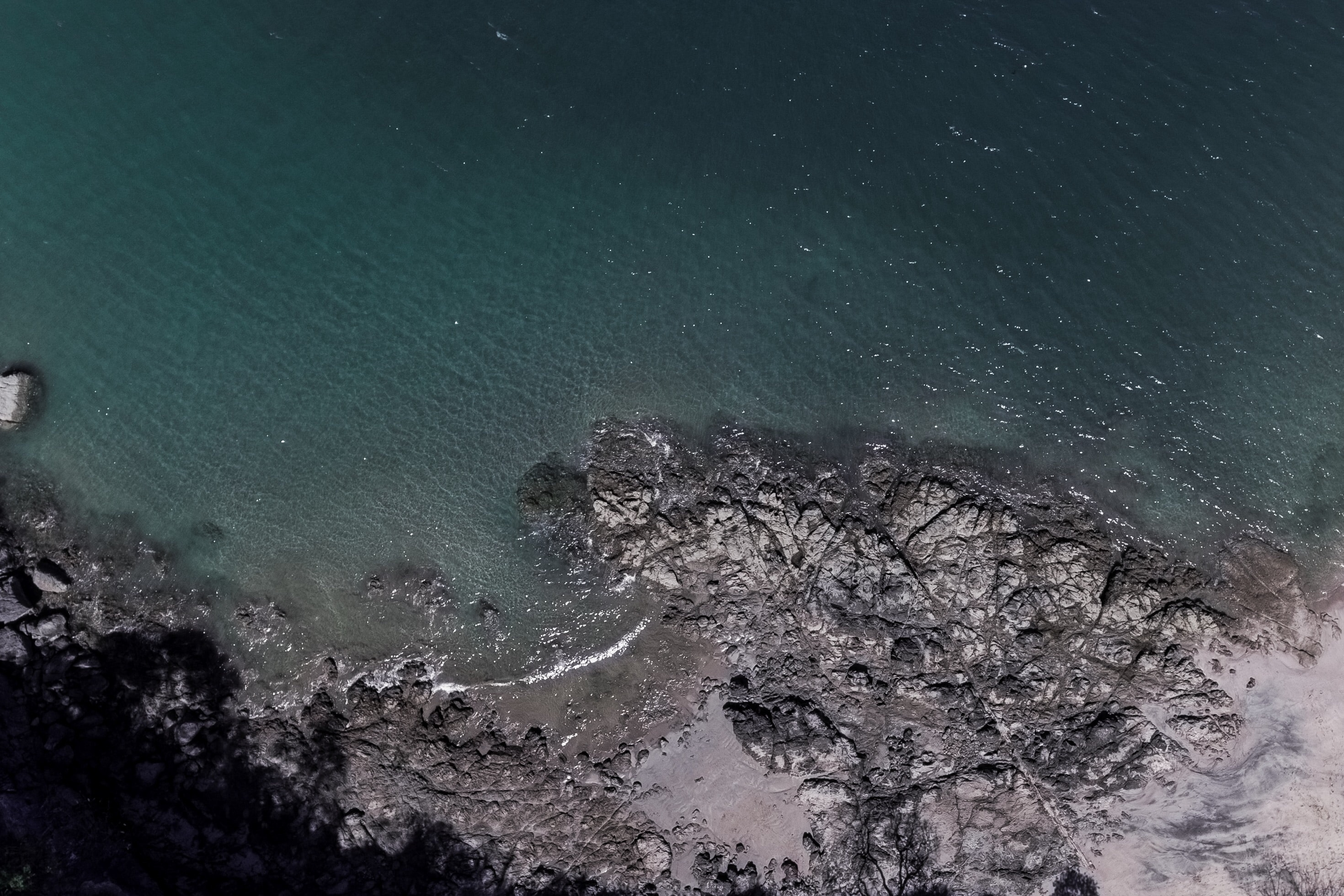 Drone view of a rocky coast by the ocean in FlamingoCostaRica