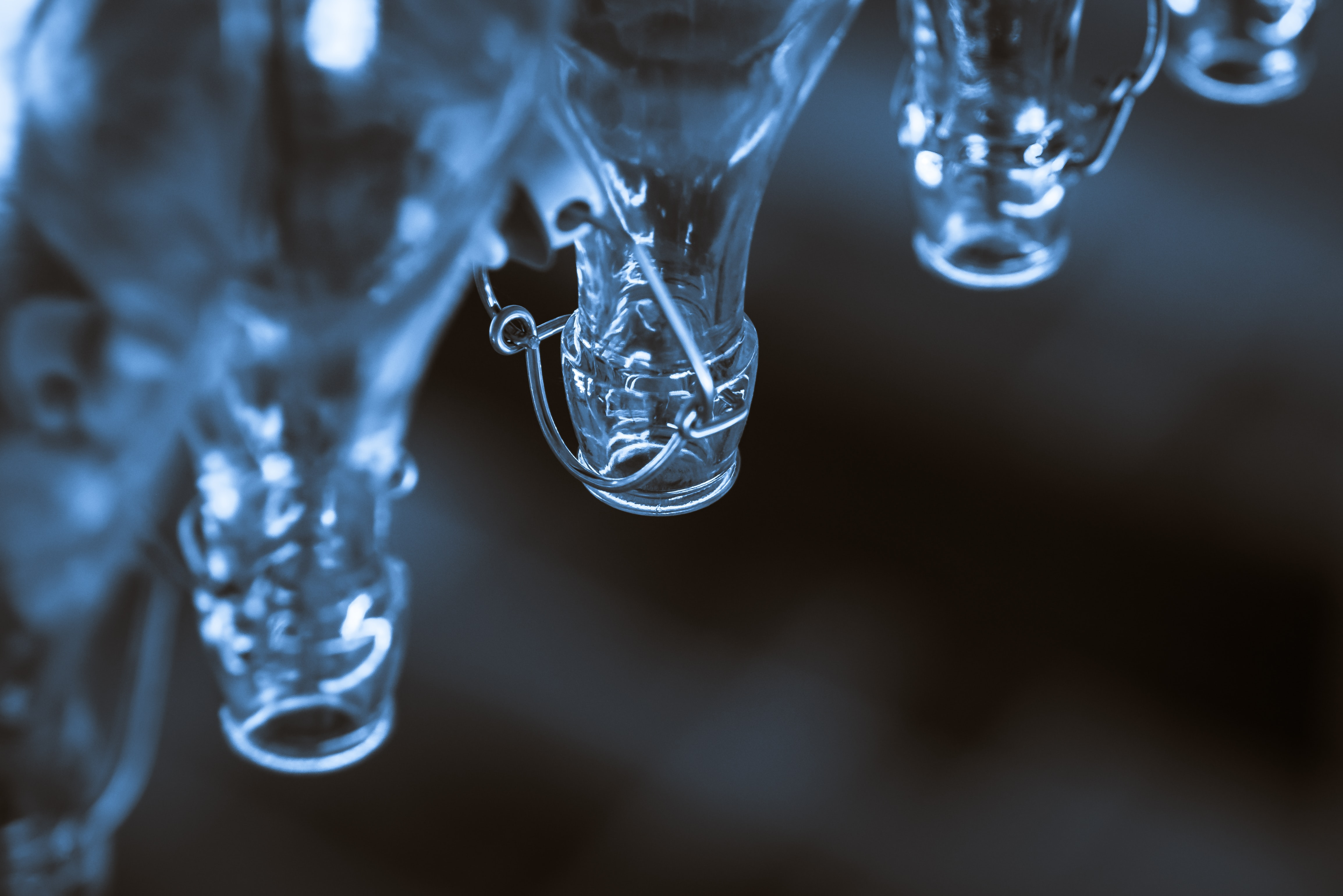 macro shot photography of clear glass bottles