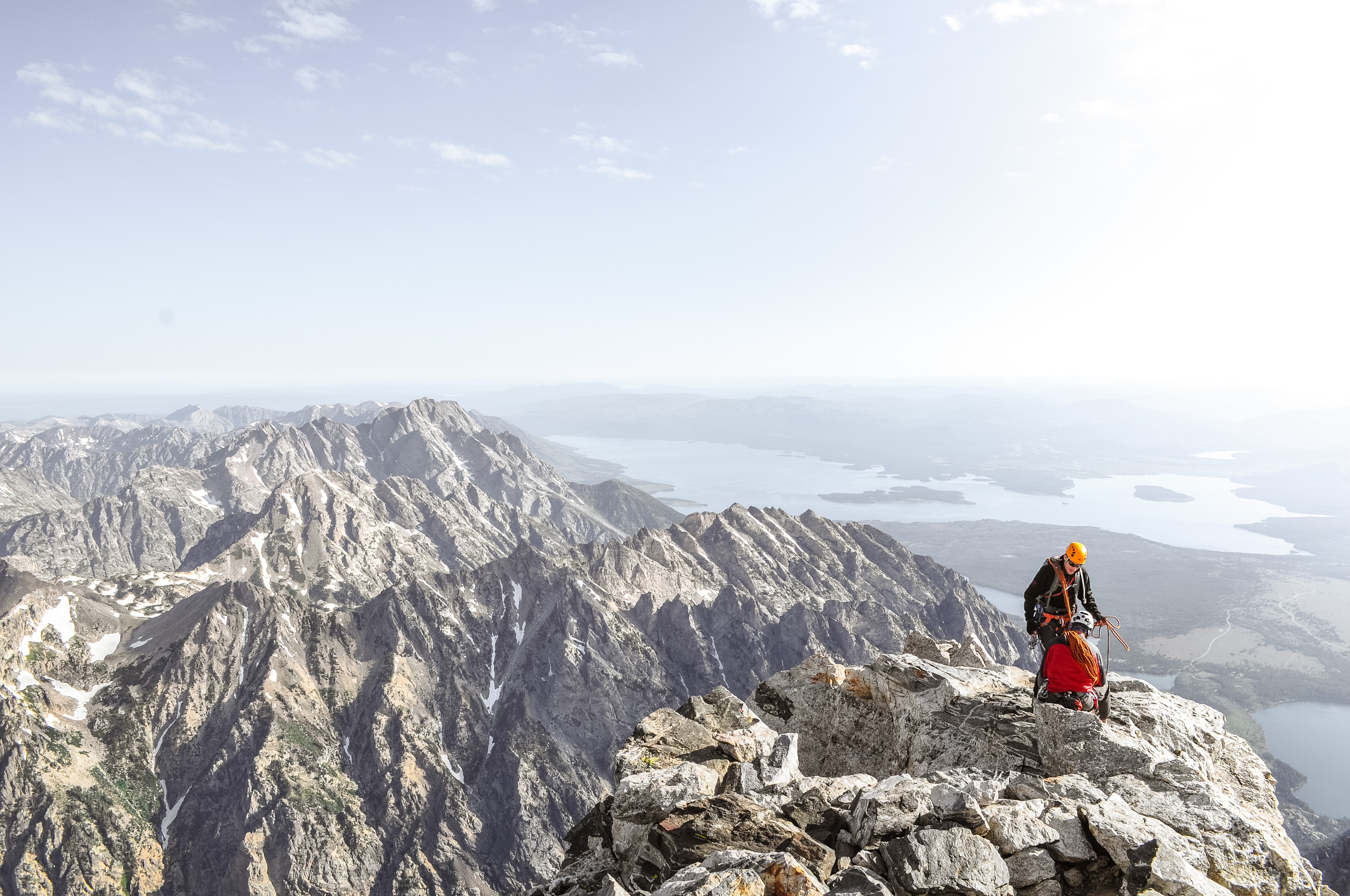 photo of man on top of mountain during daytime