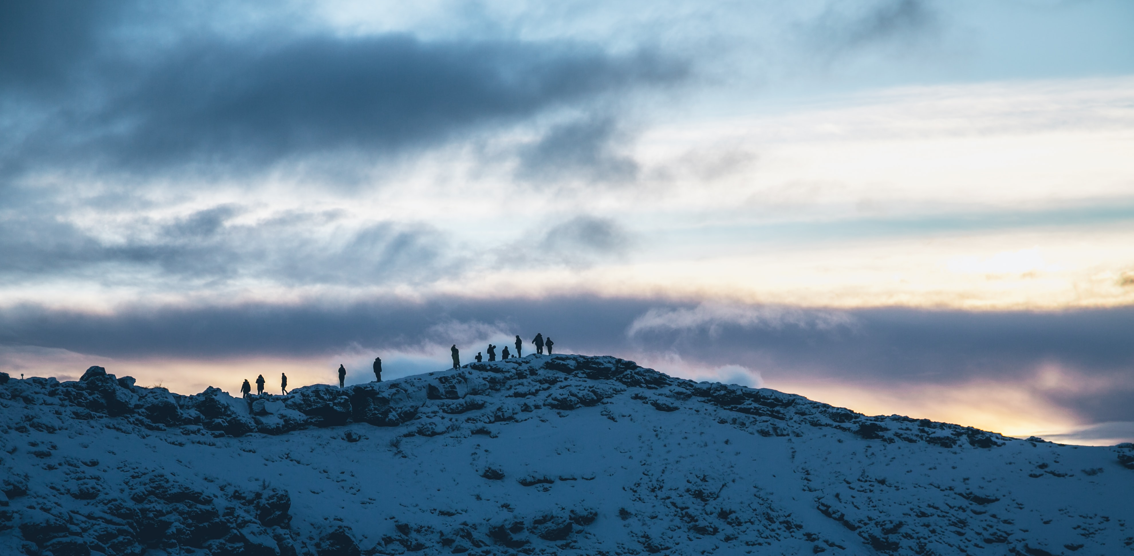 silhouette of people on mountain