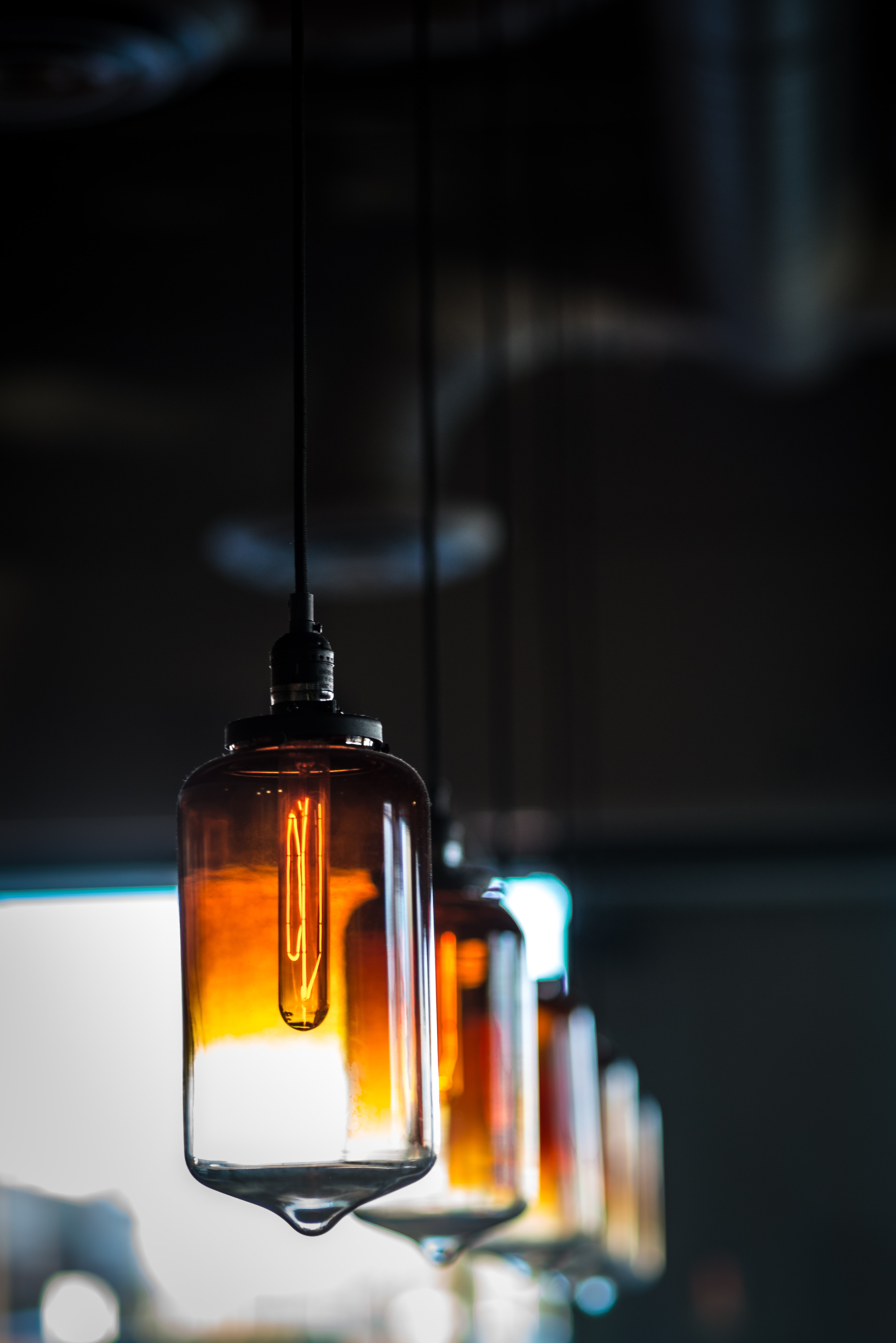 photo of white amber glass lamps