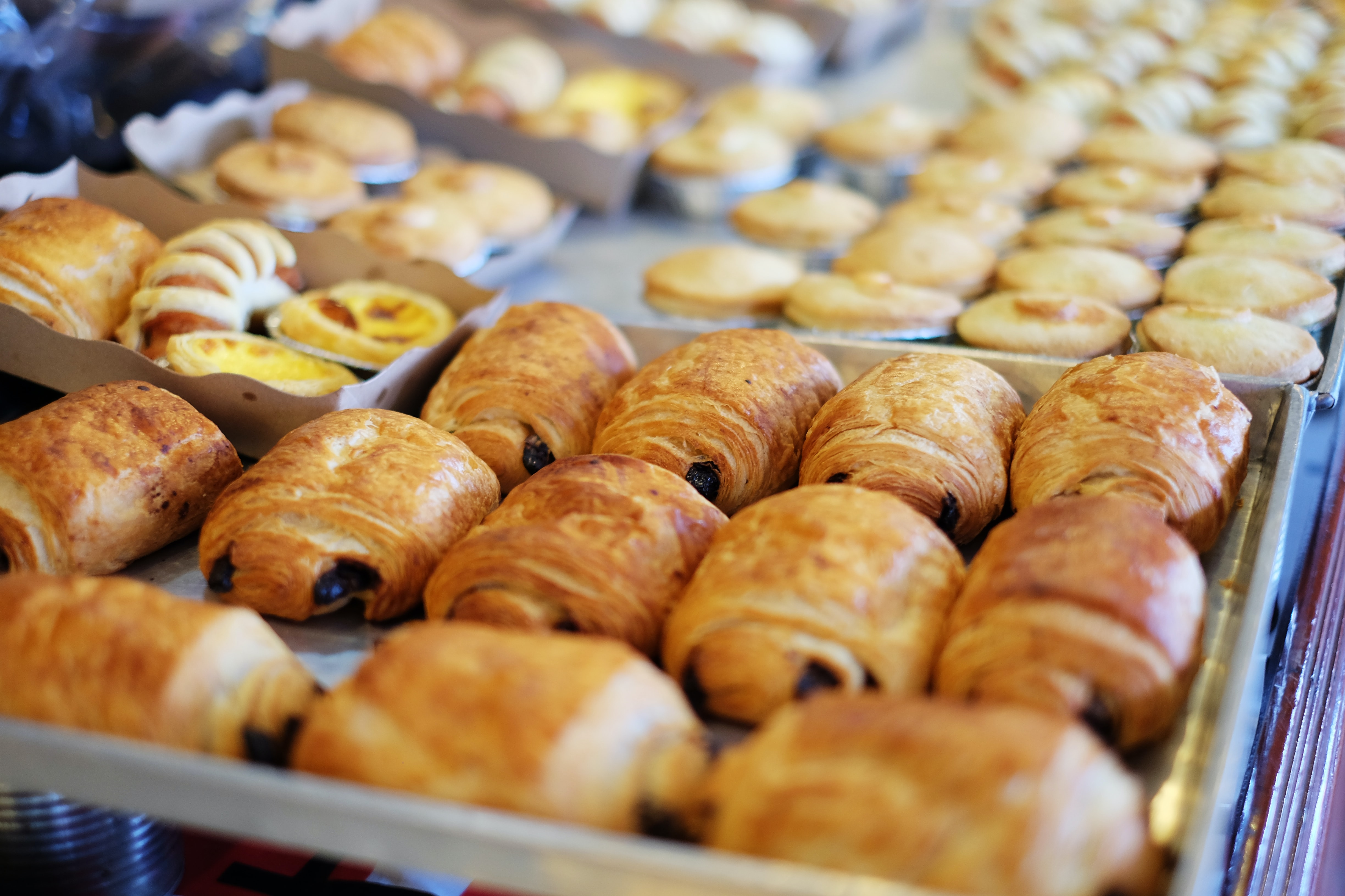Trays at a French bakery with pain au chocolat