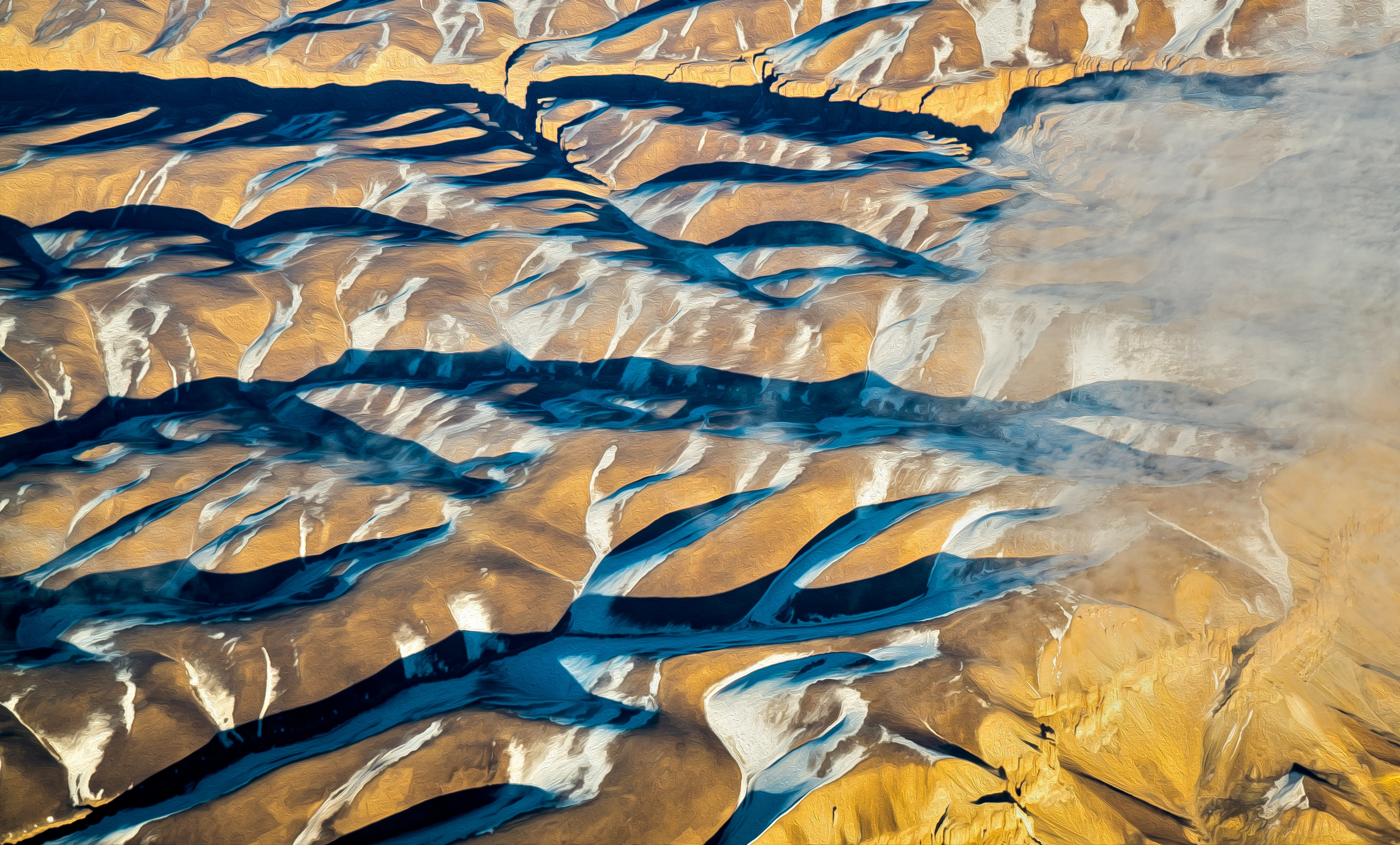 Wavy patterns through the sandy terrain of a desert in Afghanistan