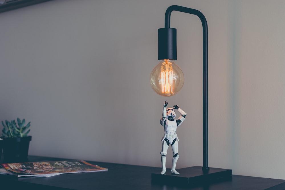 Storm Trooper vinyl figure under desk lamp