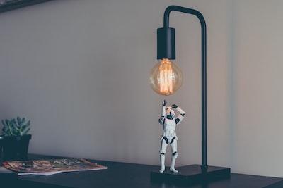 storm trooper vinyl figure under desk lamp creative zoom background