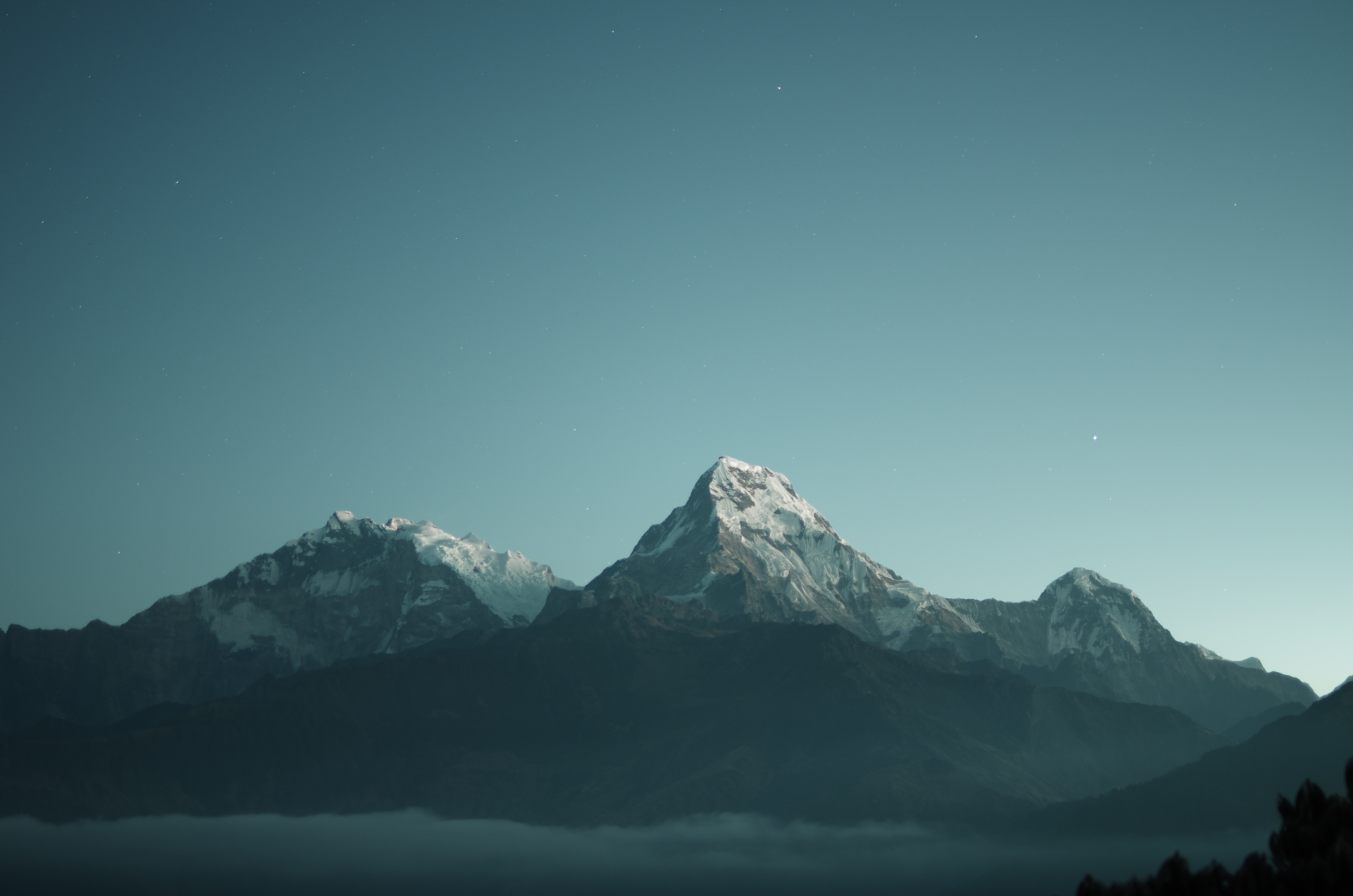 Soaring snow-capped mountains under the evening sky