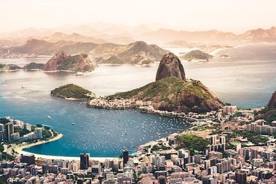 aerial photography of cityscape near sea rio de janeiro teams background