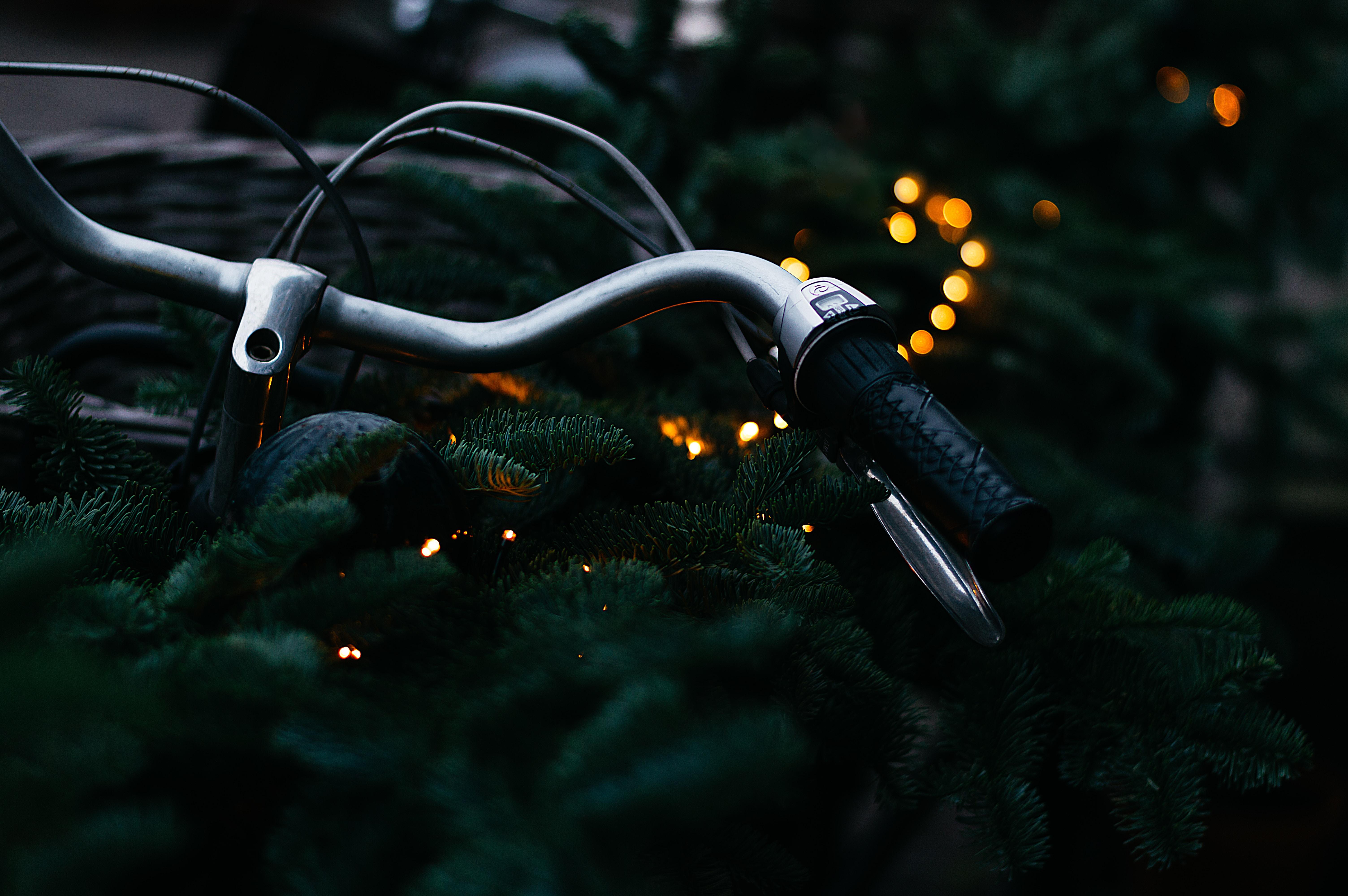 bokeh photography of gray bicycle