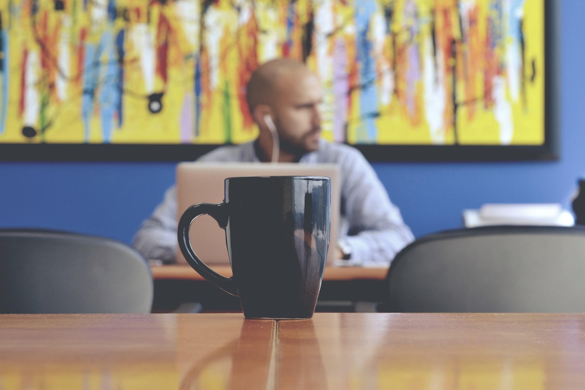 Working man behind a mug