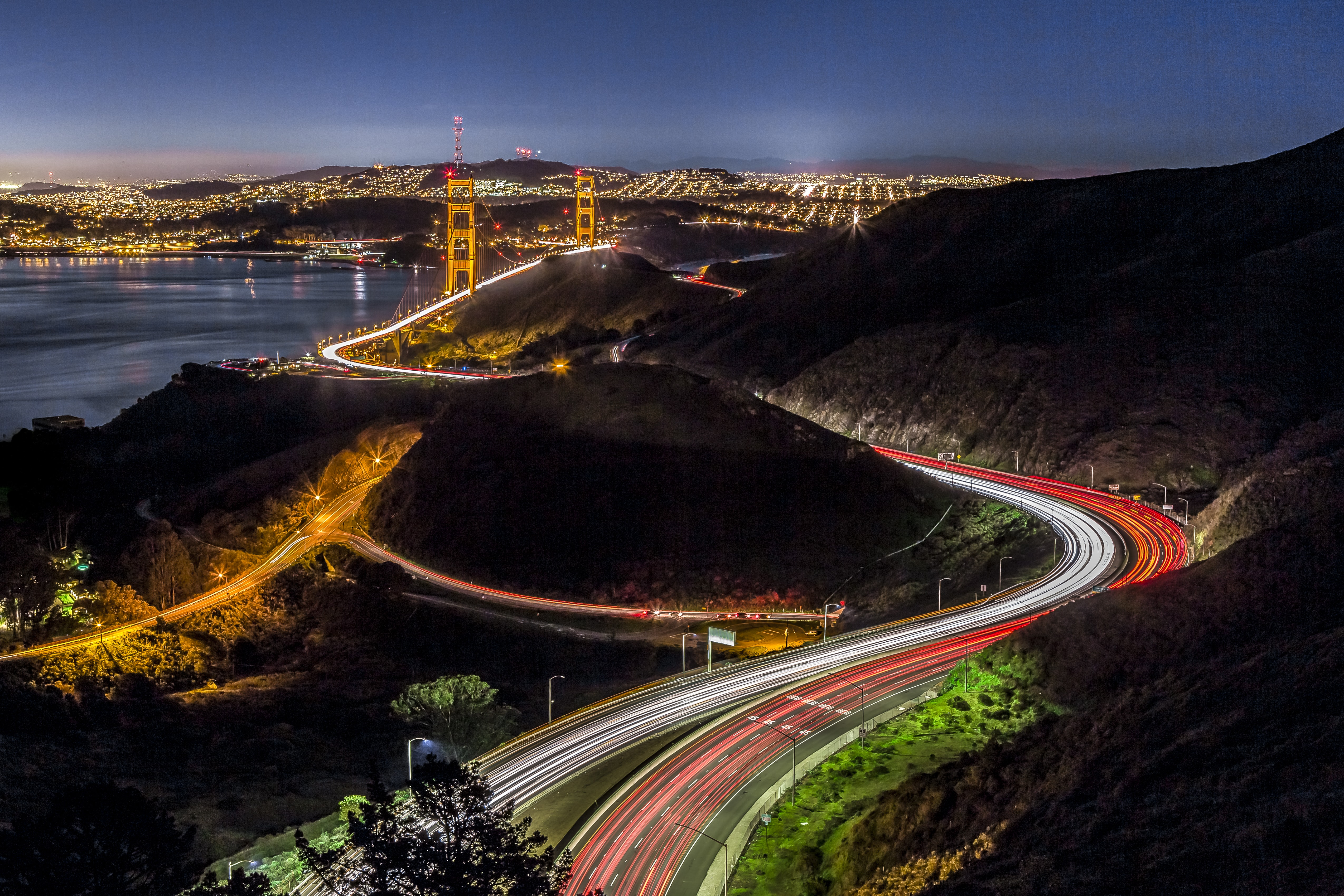 Long exposure of San Francisco traffic at night with the Golden Gate bridge in the background