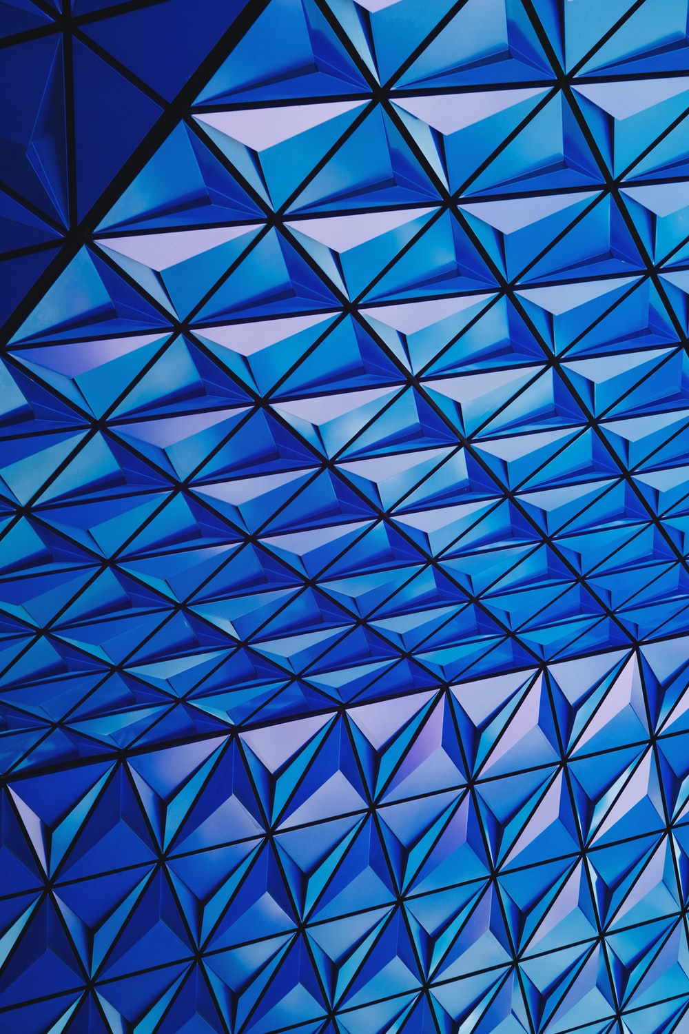 architectural photography of blue glass celing