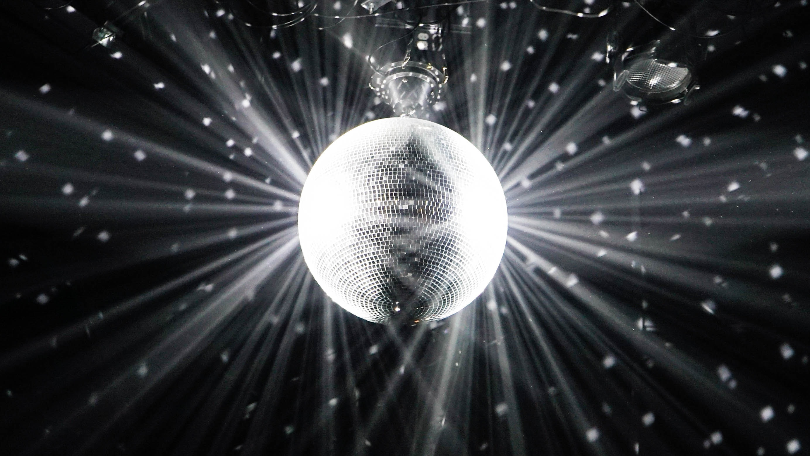 grayscale photography of disco ball