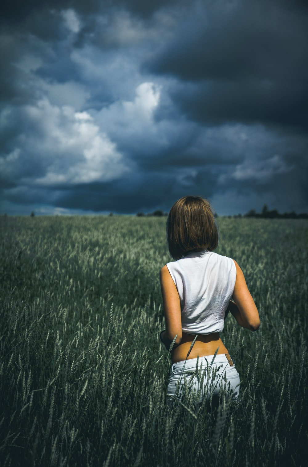 woman in sleeveless top on plants field